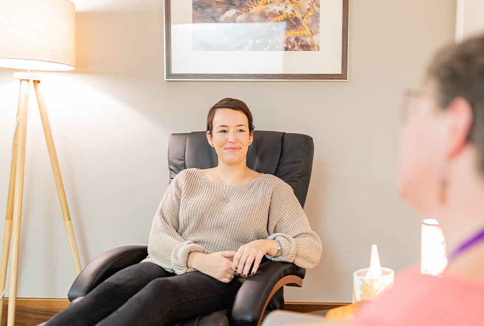 Patient sitting at treatment consultation